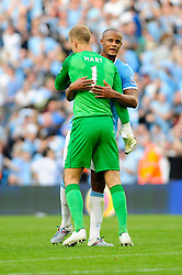 Manchester City's Vincent Kompany congratulates Manchester City's Joe Hart after the game - Photo mandatory by-line: Dougie Allward/JMP - Tel: Mobile: 07966 386802 22/09/2013 - SPORT - FOOTBALL - City of Manchester Stadium - Manchester - Manchester City V Manchester United - Barclays Premier League