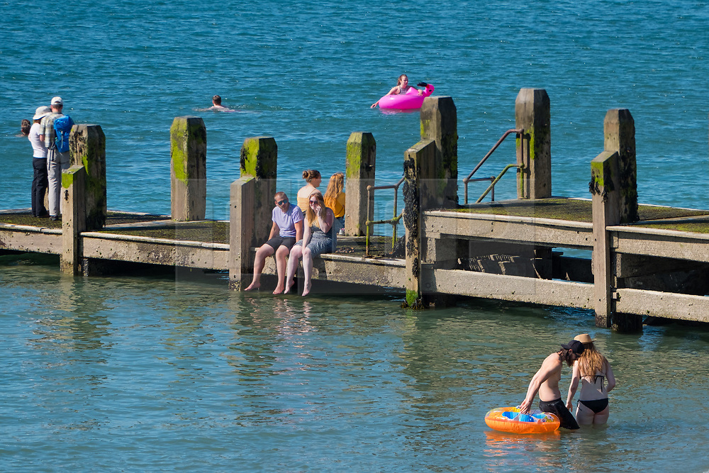 © Licenced to London News Pictures<br /> 02 July 2018 . Aberystwyth Wales UK<br /> <br /> UK Weather:  People at the seaside in Aberystwyth as the scorchingly hot  and very dry weather continues to dominate the UK.<br /> After a brief respite overnight, with some light rain, the searing heat has returned , with temperatures  again rising to the low 30º's this week<br /> <br /> photo creditKeith Morris / London News Pictures