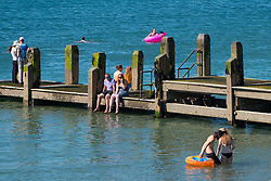 &copy; Licenced to London News Pictures<br /> 02 July 2018 . Aberystwyth Wales UK<br /> <br /> UK Weather:  People at the seaside in Aberystwyth as the scorchingly hot  and very dry weather continues to dominate the UK.<br /> After a brief respite overnight, with some light rain, the searing heat has returned , with temperatures  again rising to the low 30&ordm;&rsquo;s this week<br /> <br /> photo credit&nbsp;Keith Morris / London News Pictures