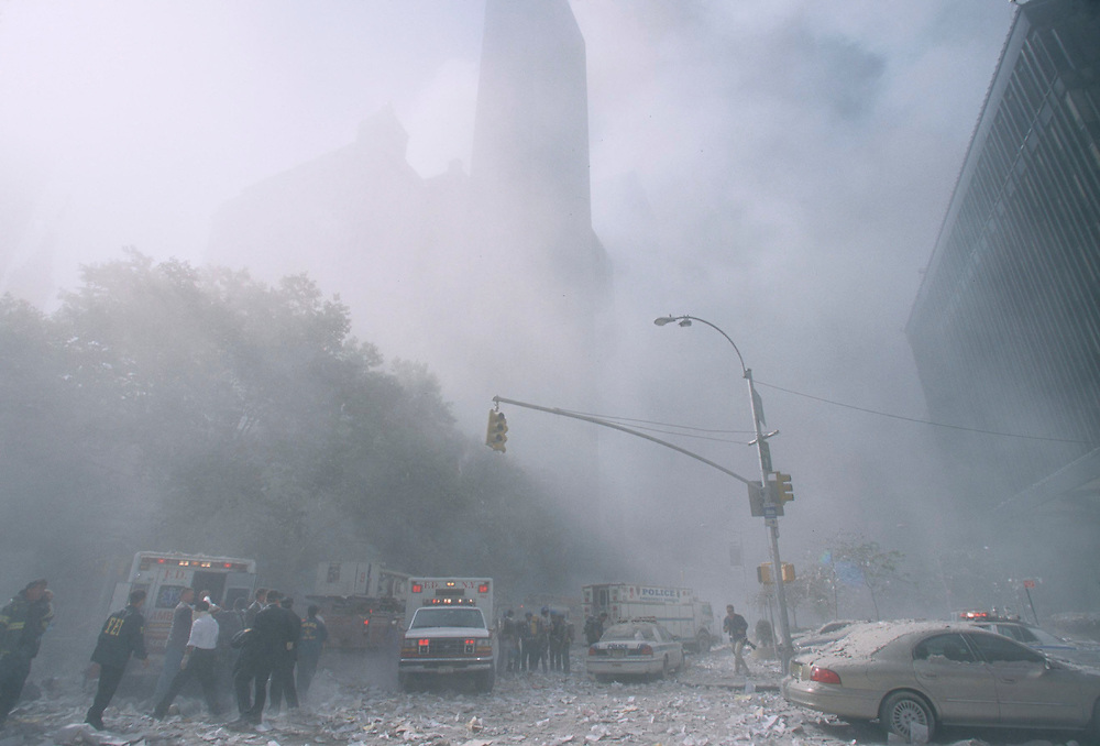 Debris fills the streets of lower Manhattan after the Tower One was brought down by a terrorist attack on the World Trade Center, New York City, September 11, 2001. This photo was taken at the base of Tower Two moments before it began to fall. Photo by Lisa Quinones.