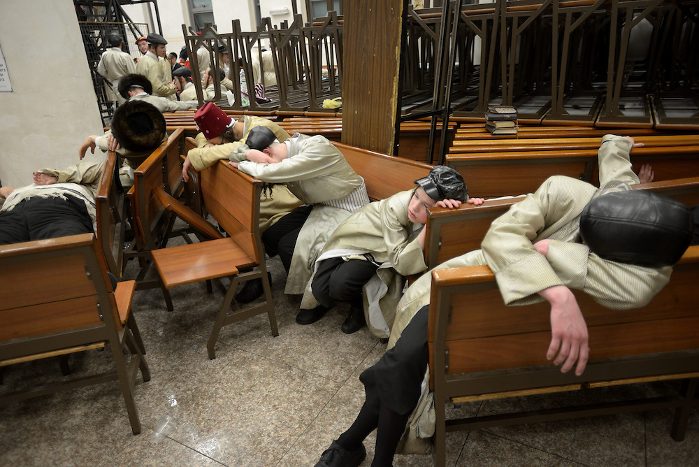 JERUSALEM, ISRAEL - MARCH 17, 2014: Ultra-Orthodox Jewish men are seen drunk during celebrations of Purim holiday in the ultra-orthodox Mea Shearim neighborhood in Jerusalem on March 17, 2014. The festival of Purim commemorates the rescue of Jews from a genocide in ancient Persia. Photo by Gili Yaari