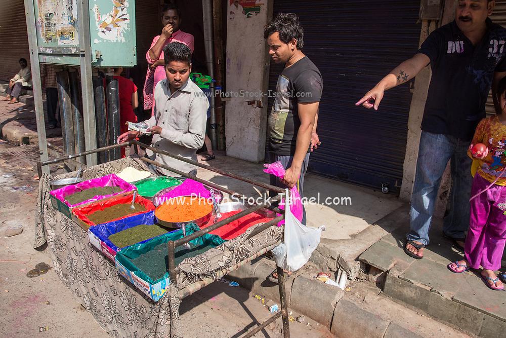 Celebrating Holi, a Hindu festival celebrating spring and love with colours. Photographed in Varanasi Uttar Pradesh, India