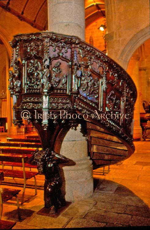 France, Brittany.   Mur de Bretagne, carved wooden pulpit.