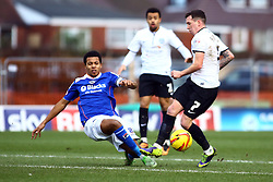 Oldham Athletic's Korey Smith in action with Peterborough United's Danny Swanson - Photo mandatory by-line: Joe Dent/JMP - Tel: Mobile: 07966 386802 25/01/2014 - SPORT - FOOTBALL - Boundary Park - Oldham - Oldham Athletic v Peterborough United - Sky Bet League One