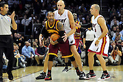 Dec. 2, 2010; Cleveland, OH, USA;  Cleveland Cavaliers point guard Mo Williams (2) gets pressure from Miami Heat center Zydrunas Ilgauskas (11) and point guard Carlos Arroyo (8) during the first quarter of the game at Quicken Loans Arena. Mandatory Credit: Jason Miller-US PRESSWIRE