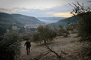 Patrolling the farmland around towns and villages in rural areas is a vital duty for the FSA, as government forces approach strategic rebal-held terrirory. Rural Idlib, near al-Janoudiyah, Idlib, Syria.