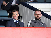 21st April 2018, Dens Park, Dundee, Scotland; Scottish Premier League football, Dundee versus St Johnstone; Dundee manager Neil McCann and youth coach Jams McPake, McCann watched the game from the stand after receiving a touchline ban