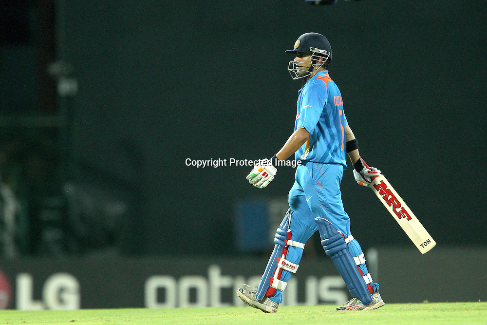 Gautam Gambhir departs after being bowled by Shapur Zadran during the ICC World Twenty20 match between India and Afghanistan held at the Premadasa Stadium in Colombo, Sri Lanka on the 19th September 2012<br /> <br /> Photo by Ron Gaunt/SPORTZPICS