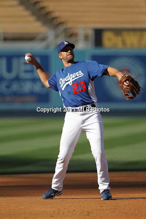 LOS ANGELES, CA - APRIL 15:  Third baseman Casey Blake #23 of the Los Angeles Dodgers throws to first base while warming up before the game between the St. Louis Cardinals and the Los Angeles Dodgers on Friday April 15, 2011 at Dodger Stadium in Los Angeles, California. (Photo by Paul Spinelli/MLB Photos via Getty Images) *** Local Caption *** Casey Blake
