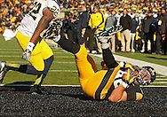 November 23 2013: Iowa Hawkeyes tight end C.J. Fiedorowicz (86) pulls in a 5 yard touchdown pass as Michigan Wolverines safety Jarrod Wilson (22) looks on during the first quarter of the NCAA football game between the Michigan Wolverines and the Iowa Hawkeyes at Kinnick Stadium in Iowa City, Iowa on November 23, 2013. Iowa defeated Michigan 24-21.