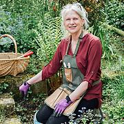 Bakewell , Derbyshire . Ann Trenneman in her garden in Derbyshire