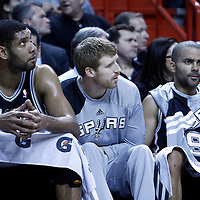 17 January 2012: San Antonio Spurs center Tim Duncan (21), San Antonio Spurs power forward Matt Bonner (15), and San Antonio Spurs point guard Tony Parker (9) are seen on the bench during the Miami Heat 120-98 victory over the San Antonio Spurs at the AmericanAirlines Arena, Miami, Florida, USA.