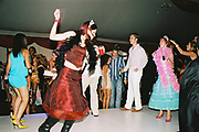Holding drinks while strutting their stuff on the dancefloor, Posh at Addington Palace, UK, August, 2004