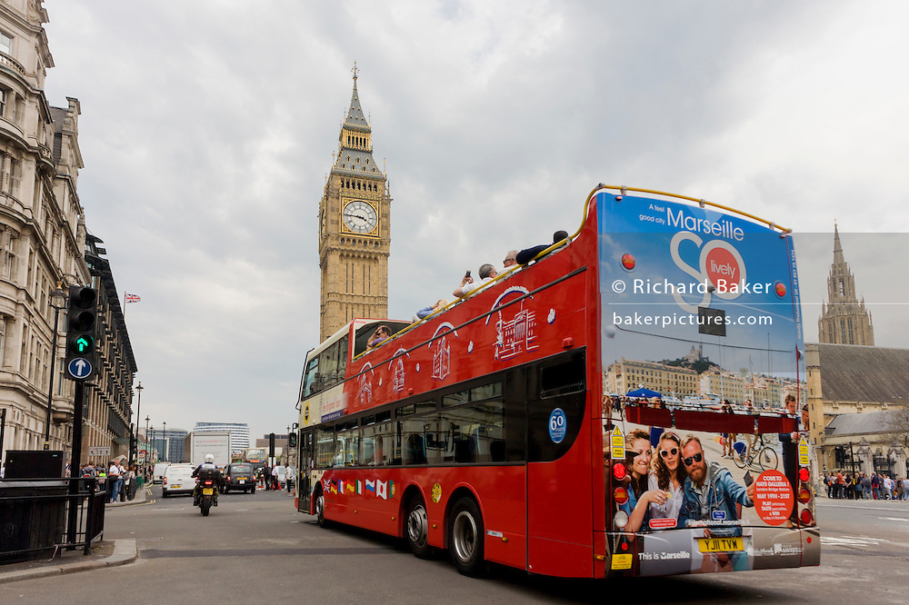 The southern French city of Marseille appears as an advert on the rear of a London tour bus travelling through the capital's streets, through Parliament Square.