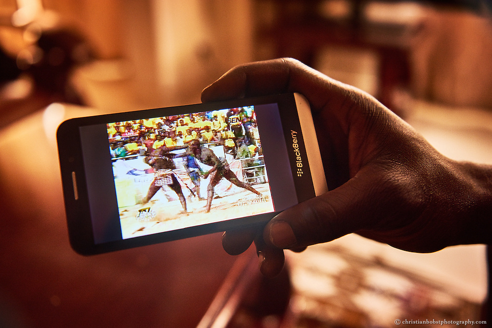 April 4, 2015. Kherou Ngor shows a video of his last big fight on his Smartphone, from which he arose as regional lightweight champion.