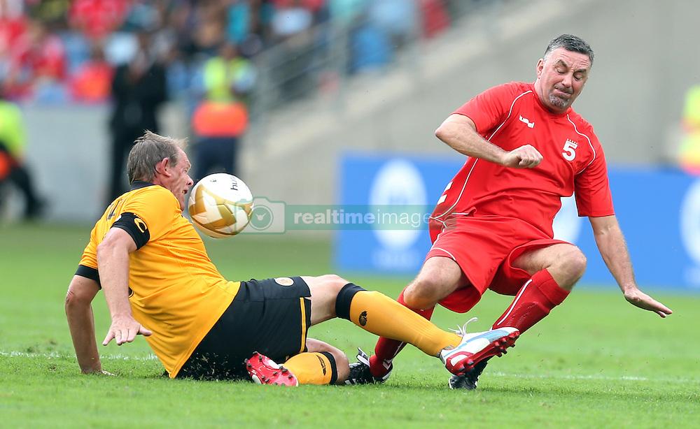 DURBAN, SOUTH AFRICA - NOVEMBER 16: Neil Tovey looking to tackle John Aldridge during the Liverpool  Legends vs Kaizer Chiefs Legends Match (Moses Mabhida Stadium) DURBAN, SOUTH AFRICA - NOVEMBER 16<br /> (Photo by Steve Haag)