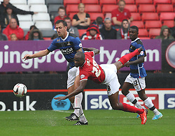 Doncaster Rovers' Chris Brown and Charlton Athletic's Leon Cort fight for the ball  - Photo mandatory by-line: Robin White/JMP - Tel: Mobile: 07966 386802 24/08/2013 - SPORT - FOOTBALL - The Valley - Charlton -  Charlton Athletic V Doncaster Rovers - Sky Bet League Two
