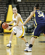 08 February 2007: Iowa guard Kristi Smith (11) looks for an opening while being guarded by Michigan guard Jessica Minnfield (34) in Iowa's 66-49 win over Michigan at Carver-Hawkeye Arena in Iowa City, Iowa on February 8, 2007.