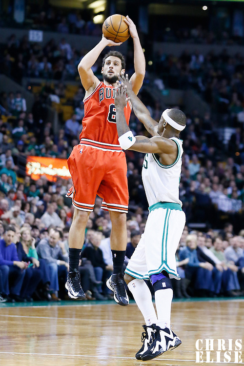 13 February 2013: Chicago Bulls shooting guard Marco Belinelli (8) takes a jumpshot over Boston Celtics shooting guard Jason Terry (4) during the Boston Celtics 71-69 victory over the Chicago Bulls at the TD Garden, Boston, Massachusetts, USA.
