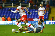 Callum O'Hare of Coventry City (17) tackles Chiedozie Ogbene of Rotherham United (19) during the EFL Sky Bet League 1 match between Coventry City and Rotherham United at the Trillion Trophy Stadium, Birmingham, England on 25 February 2020.