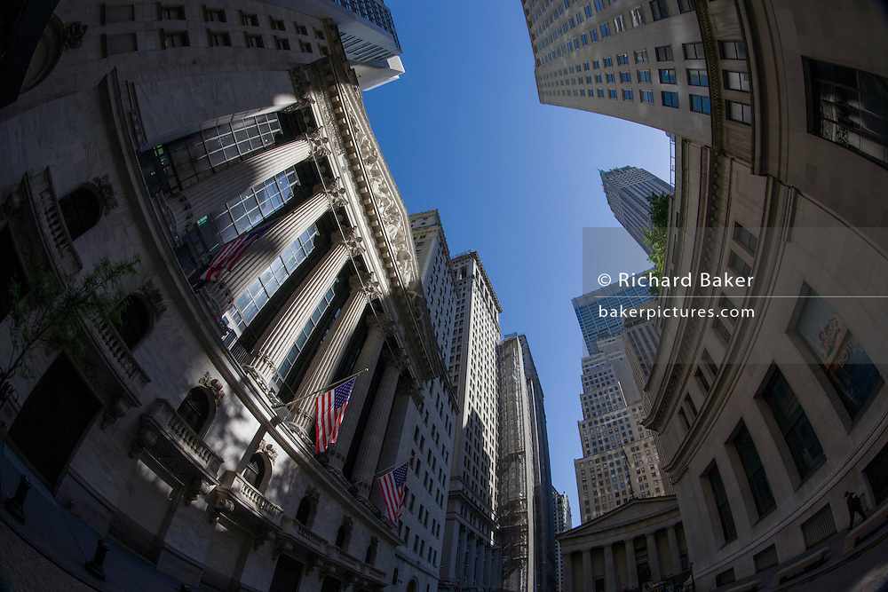 Distorted fish-eye lens view of the New York Stock Exchange (NYSE) on Wall Street, Lower Manhattan,.