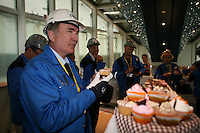 Oasis of the Seas at the shipyard in Turku, Finland where she is being built..Press conference. .Richard Fain, Chairman and CEO Royal Caribbean Cruises LTD enjoys a cup cake.