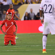 EAST RUTHERFORD, NEW JERSEY - JUNE 17: Christian Cueva #10 of Peru after being fouled during the Colombia Vs Peru Quarterfinal match of the Copa America Centenario USA 2016 Tournament at MetLife Stadium on June 17, 2016 in East Rutherford, New Jersey. (Photo by Tim Clayton/Corbis via Getty Images)