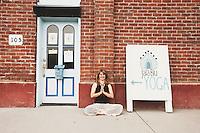 Woman outside her rural yoga studio.