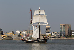 © Licensed to London News Pictures. 15/06/2016. LONDON, UK.  The historic tall ship, Jantje passes through the Thames Barrier, in front of Canary Wharf and the O2. The Sail Royal Greenwich Tall Ship Festival runs until this Sunday, 18th Septmeber.  Photo credit: Vickie Flores/LNP