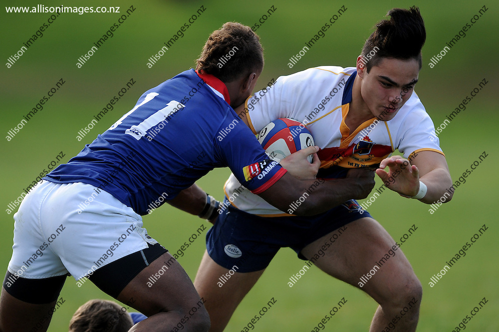 Josh Timu of John McGlashan looks to break out of the defence, during the Otago Secondary School Rugby Competition match between John McGlashan College 1st XV and St Kevins College 1st XV, held at St Kevins College, Oamaru, New Zealand, 16th May 2015. Credit: Joe Allison / allisonimages.co.nz