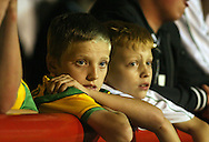 London - Tuesday, August 18th, 2009: Dejected Norwich fans during the game between Brentford and Norwich City during the Coca Cola League One match at Griffin Park, London. (Pic by Chris Ratcliffe/Focus Images)