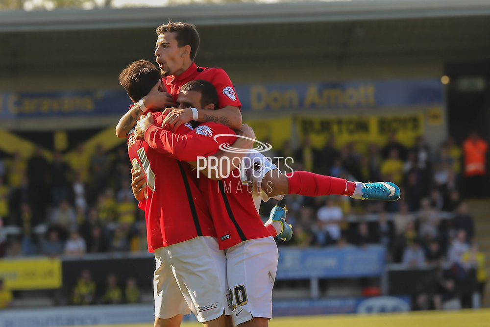 Coventry City midfielder Ruben Lameiras and Coventry City forward Marcus Tudgay celebrate with goalscorer Coventry City defender Aaron Martin during the Sky Bet League 1 match between Burton Albion and Coventry City at the Pirelli Stadium, Burton upon Trent, England on 6 September 2015. Photo by Simon Davies.