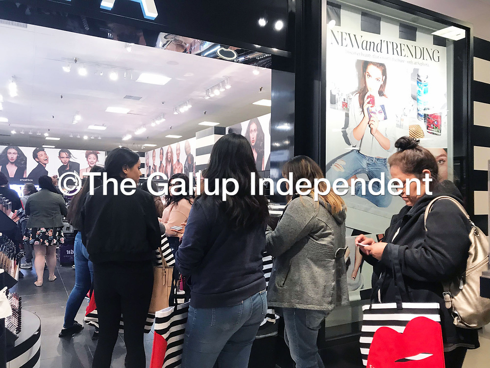 Customers stand in line for the opening of Sephora, located inside JCPenney in the Rio West Mall in Gallup, Friday morning. The opening was a hit with customers who received gift bags and makeup samples.