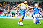 Mansfield Town forward Kane Hemmings (23) is tackled byduring the EFL Sky Bet League 2 match between Chesterfield and Mansfield Town at the Proact stadium, Chesterfield, England on 14 A pril 2018. Picture by Nigel Cole.