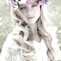 Female youth outdoors with flowers in headdress