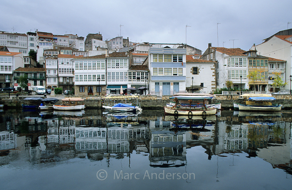Houses & boats along a river in Pontedeume, a seaside town in Galicia, Spain