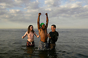 Pastors of City Tribe Church congratulate Carlin Diaz after they baptized him  in the ocean at North Beach on Sandy Hook. The church helps homeless and troubled people in community.