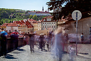 """Crowds walking down from Prague Castle towards the Townhall Stairs """"Radnicke schody"""" and """"Nerudova street"""" on the left."""
