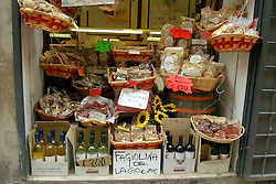 Castiglione del Lago:  A shop window shows off regional food specialities.