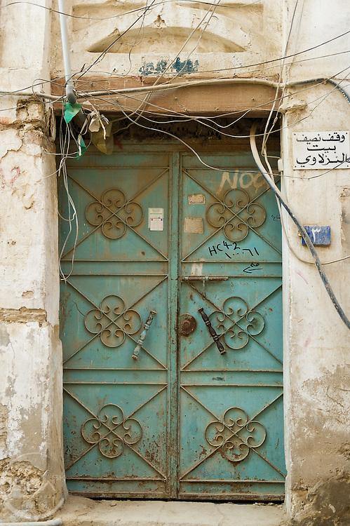 Green metal door in old town Jeddah