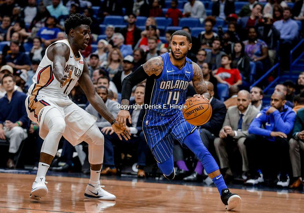 Oct 30, 2017; New Orleans, LA, USA; Orlando Magic guard D.J. Augustin (14) drives past New Orleans Pelicans guard Jrue Holiday (11) during the second quarter of a game at the Smoothie King Center. Mandatory Credit: Derick E. Hingle-USA TODAY Sports