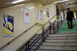 © Licensed to London News Pictures. 03/12/2011, London, UK. Poster leading to the station's platforms. Staff working at Richmond Station in London have uncovered railway posters from the late 1980's whilst upgrading poster holders. Photo credit : Stephen Simpson/LNP