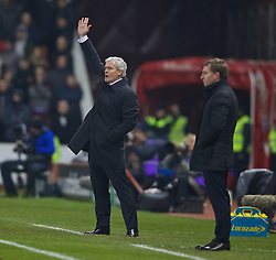 STOKE-ON-TRENT, ENGLAND - Sunday, January 12, 2014: Stoke City's manager Mark Hughes during the Premiership match against Liverpool at the Britannia Stadium. (Pic by David Rawcliffe/Propaganda)