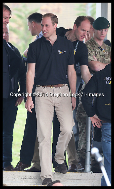 Image licensed to i-Images Picture Agency. 11/09/2014. London, United Kingdom. The Duke of Cambridge and Prince Harry arriving for a Drumhead Service  at the athletics competition on day one of the Invictus Games in London. Picture by Stephen Lock / i-Images