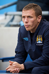MANCHESTER, ENGLAND - Saturday, November 28, 2009: Manchester City's substitute Craig Bellamy sits on the bench before the Premiership match against Hull City at the City of Manchester Stadium. (Photo by David Rawcliffe/Propaganda)
