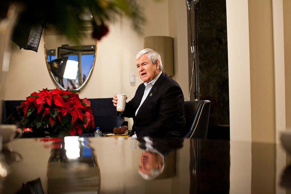 Republican presidential candidate Newt Gingrich prepares for a television interview at the Hotel Blackhawk on Tuesday, January 3, 2012 in Davenport, IA.