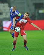 Poland, Krakow - June 04 .<br />Poland vs Lichtenstein International Friendly match at Cracovia Stadium on June 2, 2013 in Krakow.<br />Mario Frick of Lichtenstein and Artur Sobiech of Poland<br />Photo by: Piotr Hawalej