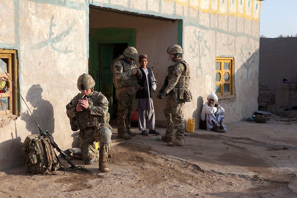 Soldiers from B Coy 3 Scots and 1PWRR prepare to leave a compound during Operation Tora Pishaw aimed at disrupting insurgent activity in their AO (Area of Operations.  Minutes later as they searched a nearby compound an IED exploded severely wounding Pte Stephen Bainbridge  who lost both legs as a result of the blast. Loya Manda, Nad e Ali North, Helmand Province, Afghanistan on the 11th of November 2011.