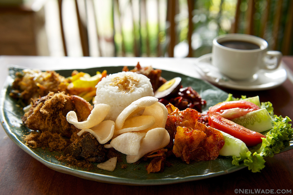 Krupuk is what those crackers are called on the front of the plate.  I found that just about every kind of Indonesian food was quite good, but got a little boring after a few weeks of eating it.