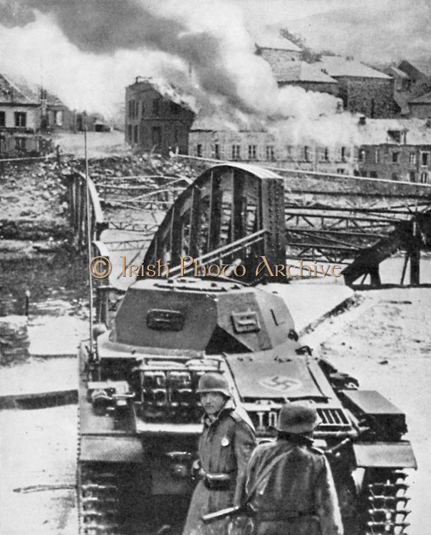 Destruction of bridge over River Meuse by the Belgians in an attempt to stop the German advance.  Here German light tank temporarily checked. 13-14 May 1940. World War 2.